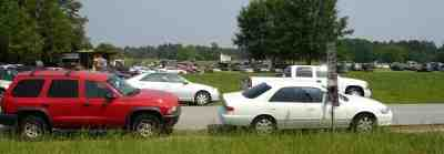 crowded parking at a strwberry u-pick field