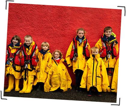 Children dressing up in RNLI crew kit